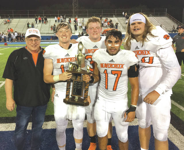 Beavercreek Mayor Bob Stone presented the traveling Backyard Battle Trophy to the Beavercreek football team captains.