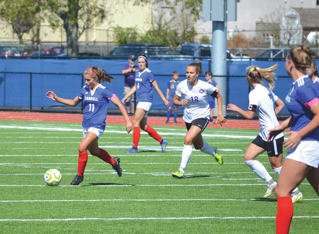 Carroll's Alaina Casey drives downfield in Saturday's game with visiting Bellbrook, at Spoerl-Bartlett Field in Riverside.