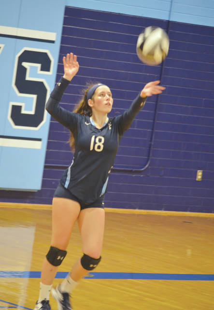 Samantha Hart of Fairborn puts up a service toss, during Thursday's five-set battle with visiting West Carrollton.