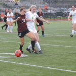 Huffman scores three, assists three in Quakers win
