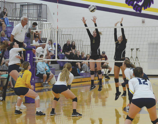 Bellbrook players Grace Krane (3) and Mallory Gedeon (7) attempt to block a shot hit by Oakwood's Carleigh Crowl, in the final game of Tuesday's Golden Eagles girls volleyball win at Bellbrook High.