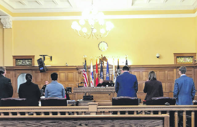 Anna Bolton | Greene County News The prosecution, left, and the defense, right, stand Sept. 25 evening as the jury — acquitting Jacob Pflanzer of rape minutes before — files out of the courtroom.