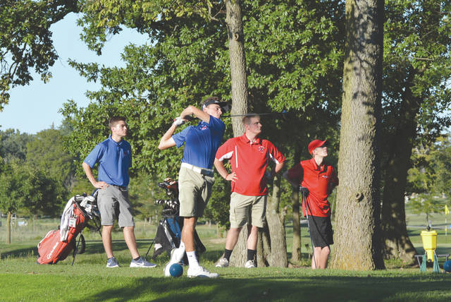 Mason Witt of Greeneview follows through on his tee shot, during Thursday's Ohio Heritage Conference high school boys varsity golf match, as teammate Matt Hovan and Cedarville golfers Logan Brennaman and Jadon Horsley look on, Sept. 5 at Locust Hills Golf Club, in Springfield.
