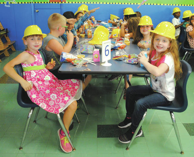 Whitney Vickers | Greene County News Fairborn Primary School students were served lunch in hard hats Sept. 16. After taking a seat to dig into their meal, they took the items out of the hat and wore them.
