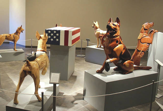 Submitted photo A temporary exhibit featuring Wounded Warrior Dog wooden sculptures by artist James Mellick will be on display at the National Museum of the U.S. Air Force from Nov. 8, 2019 through Jan. 31, 2020.