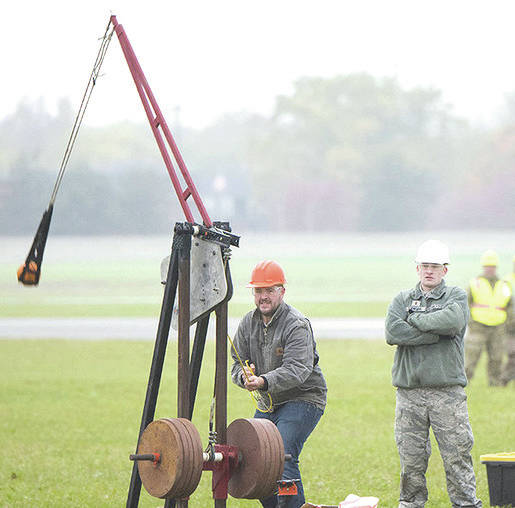 Submitted photo A team readies their machine to hurl a pumpkin into the air, competing for the longest distance in the Air Force Life Cycle Management Center's Pumpkin Chuck competition. Teams compete in three categories, which vary in size of machine, weight of pumpkin and Human-powered.