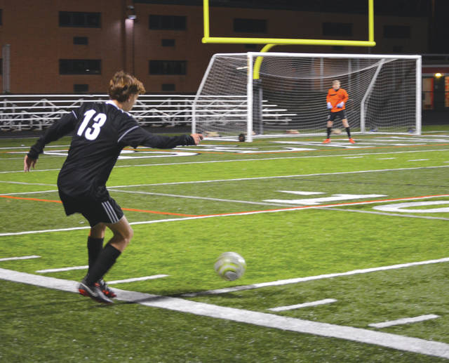Andrew Ackerson (13), a junior defender for Beavercreek, gains control of the ball in the Beavercreek zone, Oct. 12 during a regular season boys varsity soccer home match against Cincinnati Walnut Hills.