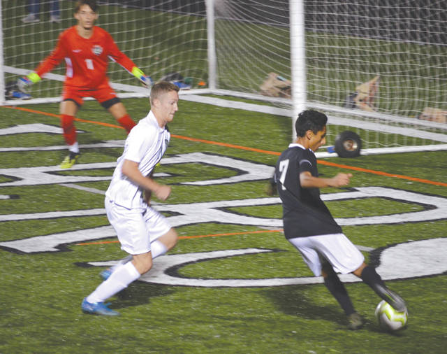 Beavercreek's Asad Patel (7) gets off a shot at the Northmont goal, during Tuesday's Oct. 8 boys soccer varsity match at Frank Zink Field in Beavercreek.