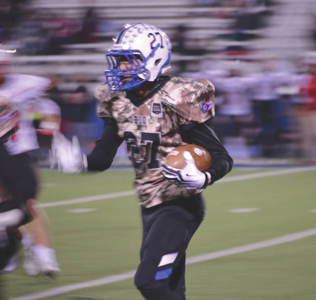 Xenia's Chris Jones (27) returned a interception 55 yards for a Buccaneers touchdown, Friday, Oct. 18 at Doug Adams Stadium in Xenia, in a win over visiting Tippecanoe.