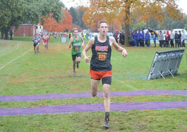 Beavercreek junior Connor Ewert crosses the finish line in fourth, in the Division I boys regional cross country race, Oct. 26 in Troy. The entire Beavercreek team advanced to this weekend's state championships.