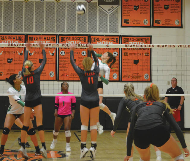 Beavercreek middle blockers Grace Phillips (10) and Krorina Swiderski (11) go up to challenge a Northmont hit, during Tuesday's Greater Western Ohio Conference varsity girls volleyball match at Beavercreek High School.