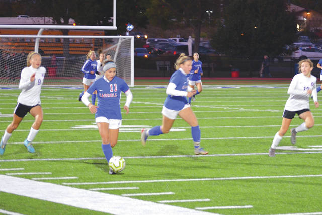 Carroll's Alaina Casey (11) takes the ball downfield, accompanied by teammate Jillian Roberts and Bellbrook's Regan Ebel (9), during Thursday's Division I girls sectional soccer match at Spoerl-Bartlett Field in Riverside.