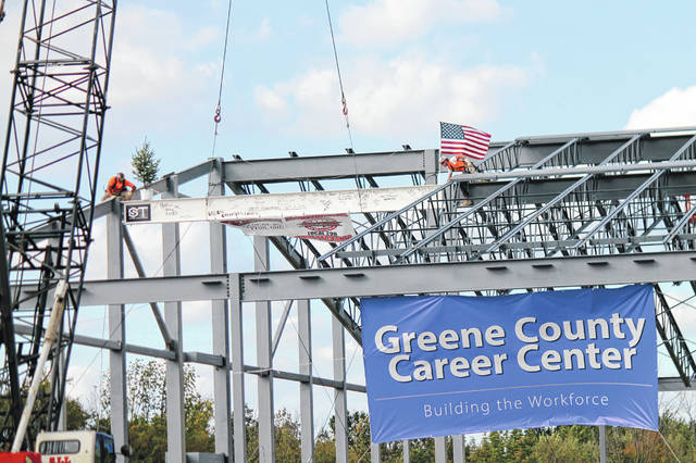 Anna Bolton | Greene County News Construction workers place the final beam on top of the new Greene County Career Center Oct. 3.