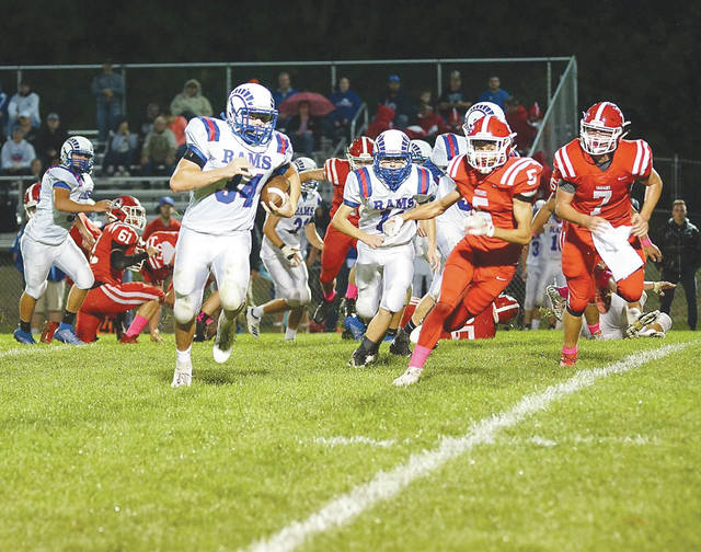 Greeneview junior Dakota Mangan (34) runs for a gain during the first half of Friday's Oct. 11 varsity high school football game at Cedarville High. Mangan rushed for 226 yards and scored a touchdown in the Rams win.