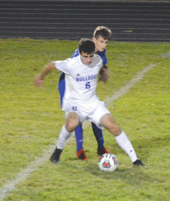Yellow Springs' Kayden Bryan (6) shields a Greeneview defender from the ball, during Thursdays varsity boys soccer match at Don Nock Field in Jamestown.