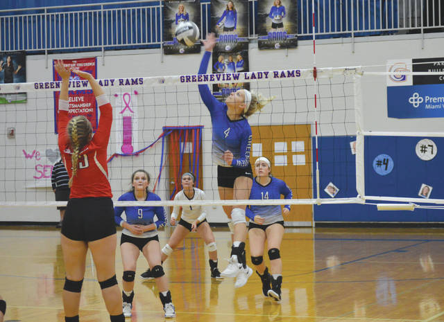Greeneview co-captain Madyson Brittingham (4) bashes a shot through the Cedarville defense, during Thursday's Ohio Heritage Conference girls varsity volleyball match in Jamestown.