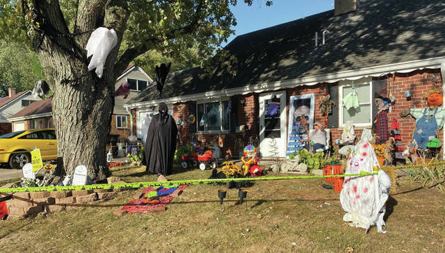 Scott Halasz | Greene County News Carol and David Tumbleson went all out this year to decorate their home for Halloween. Carol is pictured wearing the black cape.