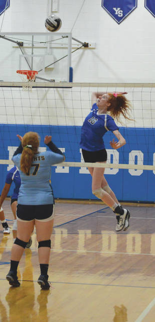 Emma Ronnebaum (16) hits a winner past a Legacy Christian defender, Oct.8, in a girls varsity high school volleyball match at Yellow Springs High School.