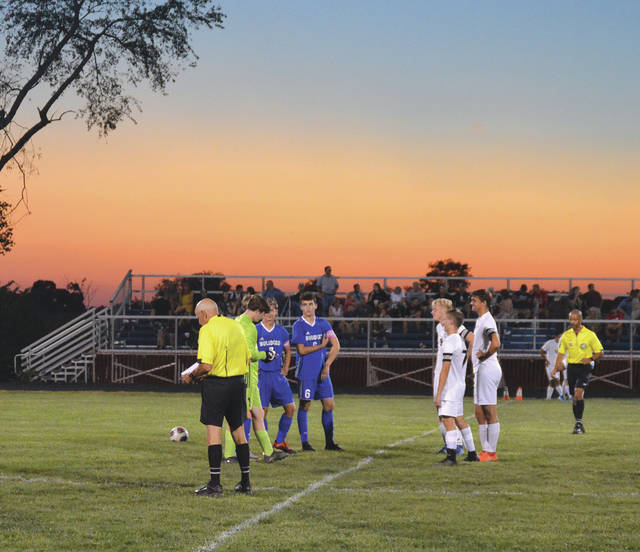 Yellow Springs and Greenon team captains meet under a beautiful sunset prior to their high school boys soccer match in at Yellow Springs High School.