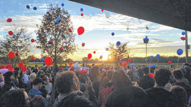 Submitted photo Community members, family and friends of Jarred Hixson and Troy Haney release balloons at a vigil to remember the Xenia teens Oct. 19 at West Side Park.