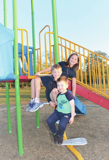 Linda Collins | Greene County News Young Bath Township residents and siblings Olivia, 10, Stellan, 5, and Edison, 3, enjoying the new playground equipment at Bath Township Park. They are the children of Chris and Sarah Tangeman.