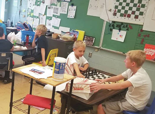 Submitted photos The Fairborn Skyhawk Chess Club is just under two weeks away from competing in the Cincinnati Chess Tournament at Fairfield High School. Club members are pictured practicing the game.