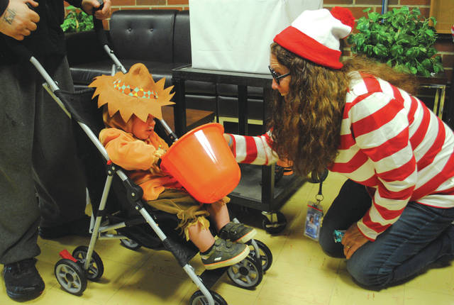 Whitney Vickers | Greene County News Fairborn Primary School hosted Trunk or Treat Oct. 30, inviting the community to step inside to receive Halloween treats at various stations set up around the FPS hallways.