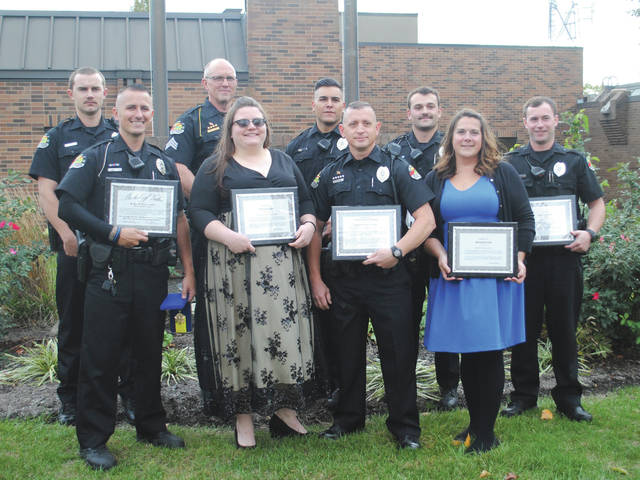 Whitney Vickers | Greene County News Pictured (not in order) are Fairborn dispatchers Amy Pease and Kristina Forsythe, in addition to officers Connor Mulcahy, Seldon Patterson, Patrick Taubert, Joe Walton and Joshua Lightner as well as K9 Unit Officer Rod Myers and Sergeant Bill Titley. They were honored by police and city officials Oct. 22 for their response to an incident that occurred in the City of Fairborn on April 2.