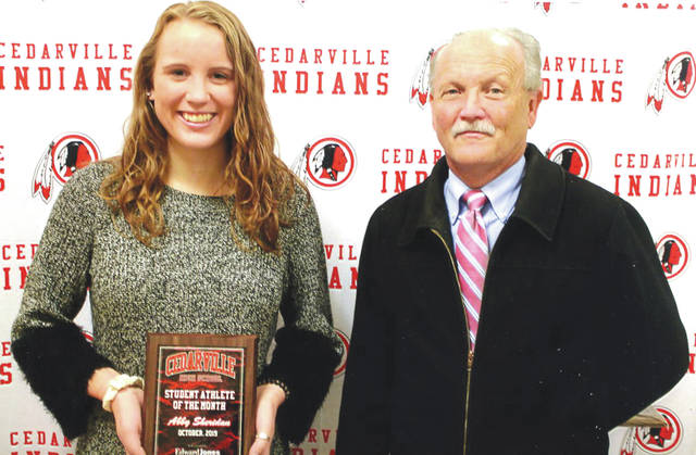 Abby Sheridan was chosen as the Edward Jones Investments Athlete of the Month for October for Cedarville High School. This award is being sponsored by the office of Mike Reed (right) at Edward Jones Investments of Xenia, serving Xenia, Jamestown, Cedarville and surrounding areas. Sheridan, a senior on the Indians volleyball team, is a two-time selection for the first team all-Ohio Heritage Conference award and a four-letter winner. She has an impressive 4.0 grade-point average.