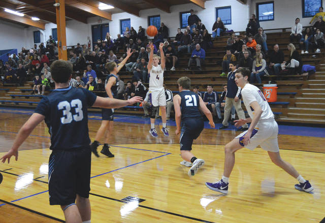 Bellbrook senior Sam Montgomery (4) lofts a shot from the left wing, during Friday's boys high school basketball season opener at the Benner Field House in Xenia. Bellbrook defeated Legacy Christian in the first game of the Benner Classic.