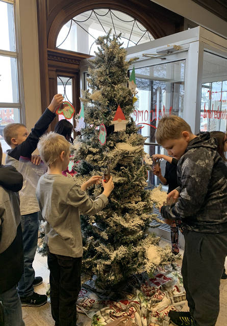 Submitted photos Third grade students from Fairborn Primary School decorated trees in downtown Fairborn in the spirit of the upcoming holiday season.