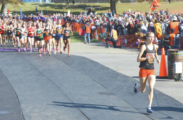 Taylor Ewert, of Beavercreek, leads the Division I girls state cross country field Nov. 2 in Hebron. Ewert won that race, and is making a return to the Foot Locker Midwest Regional Championships this weekend in Kenosha, Wisconsin.