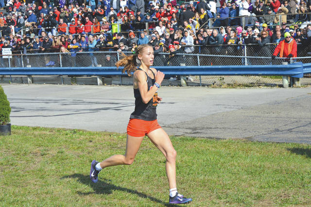Beavercreek senior and defending Division I girls cross country champion Taylor Ewert won the 2019 race with a record-setting time of 17:22.5, and the girls team defended their state title as well, Nov. 2 at National Trail Raceway in Hebron.