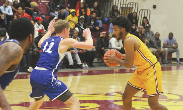 Central State University's Keandre Graves (right) was a perfect 6-for-6 from the field in Tuesday's home men's college basketball win over Urbana, in the Beacom/Lewis Gymnasium, in Wilberforce.