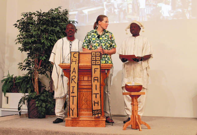 Anna Bolton | Greene County News Moussa Tembiné, of Kansongho, and Anna Taft, director of The Tandana Foundation, listen as Housseyni Pamateck, of Sal-Dimi, speaks about schools in Mali Oct. 27 at Bellbrook United Methodist Church.