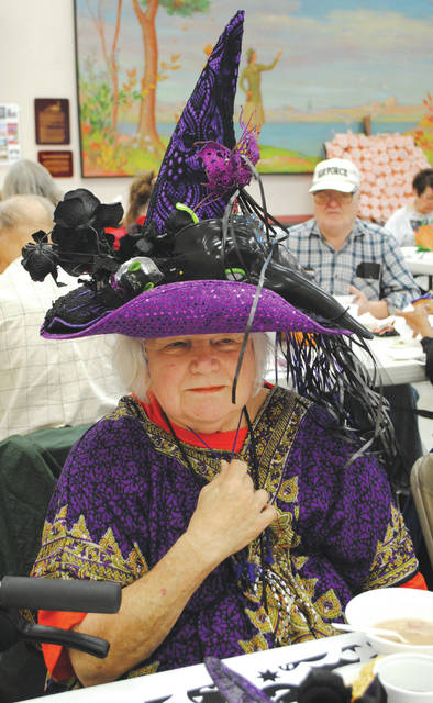 Whitney Vickers | Greene County News The Fairborn Senior Center hosted its annual Halloween party Oct. 31, inviting members to showcase their best costumes while sharing a meal and games. Attendees wore costumes such as a witch, beauty queen, bride and groom, a skeleton and more.