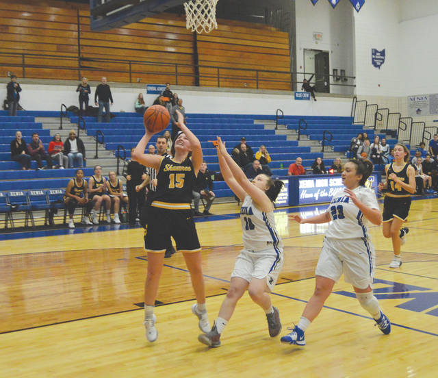 Springfield Shawnee senior Andi Meeks (15) scores the winning basket with 15.9 seconds left to play, Monday Dec. 2, in the girls basketball regular season opener for host Xenia High.