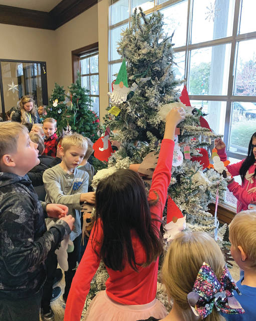 Submitted photo Third graders from Fairborn Primary School helped decorate the trees that will be located inside the former 5/3 Bank Building — where Santa Claus is expected to stop for a visit during the event.