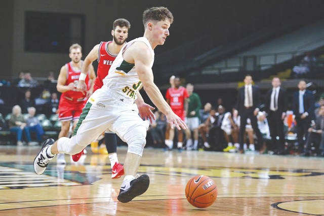 Cole Gentry drives to the bucket, during Tuesday's men's college basketball game against visiting Western Kentucky. Gentry scored the winning points in Wright State University's 76-74 win.
