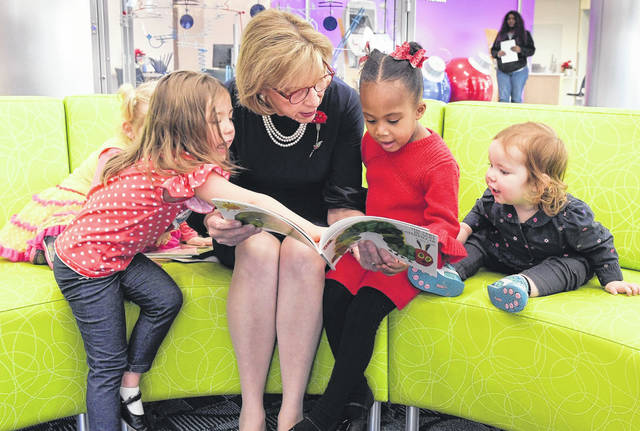 Submitted photo Ohio First Lady Fran DeWine reads to children during the launch of the Ohio Governor's Imagination Library in neighboring Montgomery County Dec. 18 at Dayton Children's Hospital. Greene County Public Library Foundation just delivered its 300,000th book to Greene County children through the program.