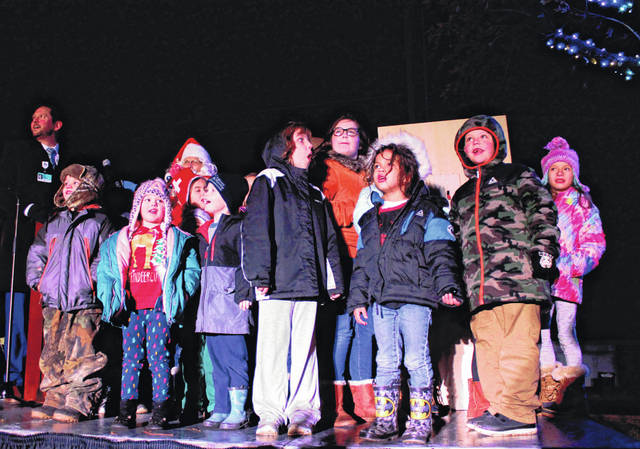 Anna Bolton | Greene County News Helping Santa Claus and Rick Dodds, president of Greene Memorial Hospital, children jump on stage to flip the switch Dec. 2, lighting up the Christmas tree for the season.