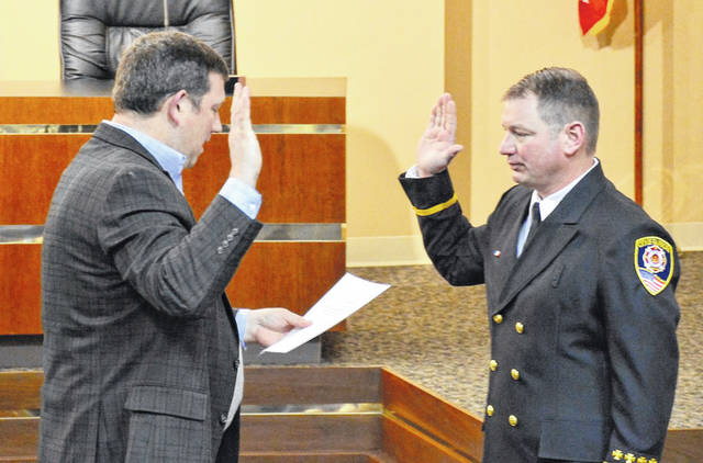 Newly promoted Fire Lt. Mike Reichert was sworn in by City Manager Rob Anderson on Friday.