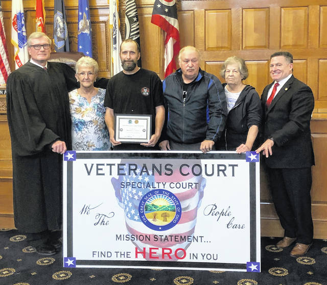 Judge Stephen A. Wolaver with Vicki Hart, Navy Veteran Michael A. Lovely, graduate, Doyle Lovely, mother and father and Darlene Lovely, step mother and State Rep. Rick Perales, USAF retired, at the recent graduation ceremony of Veterans Treatment Court held in the Greene County Main Courtroom.