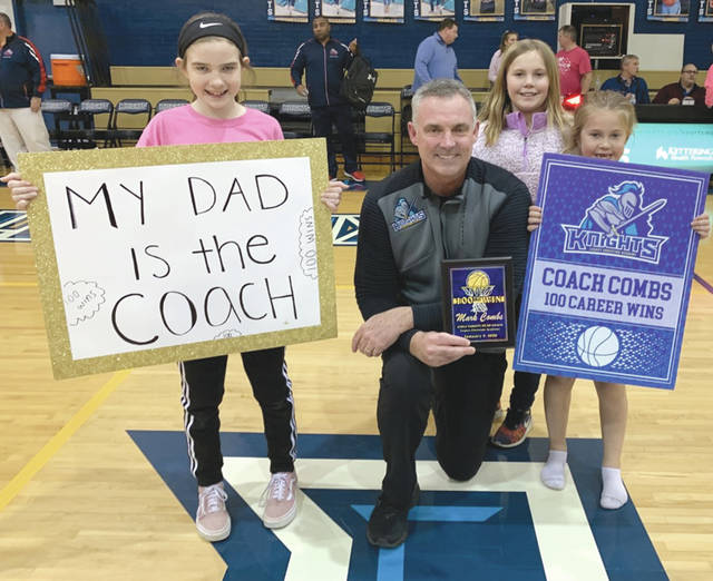 Legacy Christian Academy girls varsity basketball coach Mark Combs poses with his daughter, Ava (left), and his nieces after winning his 100th career game as a coach, Jan. 9 in Xenia.