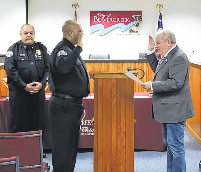 Photos courtesy City of Beavercreek Beavercreek Mayor Bob Stone swears in the city's newest police officer, Warren E. Edmondson Jan. 6. Chief Dennis Evers opened the ceremony and Officer Edmondson's wife pinned his badge. Edmondson is a graduate of Xenia High School, served in the United States Navy, attended Sinclair Community College and the Greene County Criminal Justice Training Academy, and worked as a deputy sheriff in Miami County.