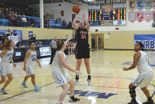 Beavercreek's Anna Landing (34) puts up a jump shot during the first half of Monday's girls high school varsity basketball game, Jan. 13 at Baker Middle School in Fairborn.
