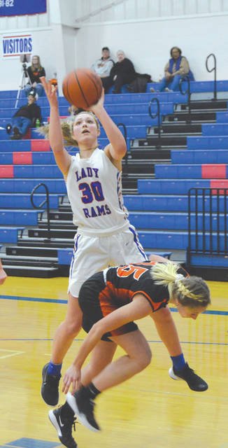 Greeneview senior guard Sylvie Sonneman (30) puts up a shot over Grace Estes of West Liberty-Salem, Jan. 2 in Jamestown. Sonneman led all scorers with 24 points in a home loss.