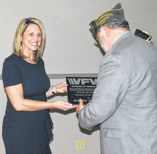 Photos by Anna Bolton | Greene County News Jennifer McGowan accepts the VFW Teacher of the Year Award Jan. 14 from Beavercreek Memorial Post 8312 Commander Erik Swanson.