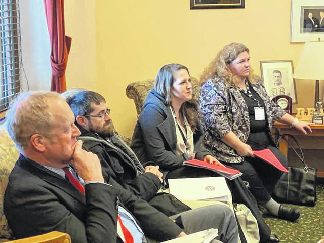 Greene County Farm Bureau's Craig Corry, Darren Reed, and Kelsey Randall were part of the Greene County contingent that took part in Ag Day on February 19 at the Ohio Statehouse.