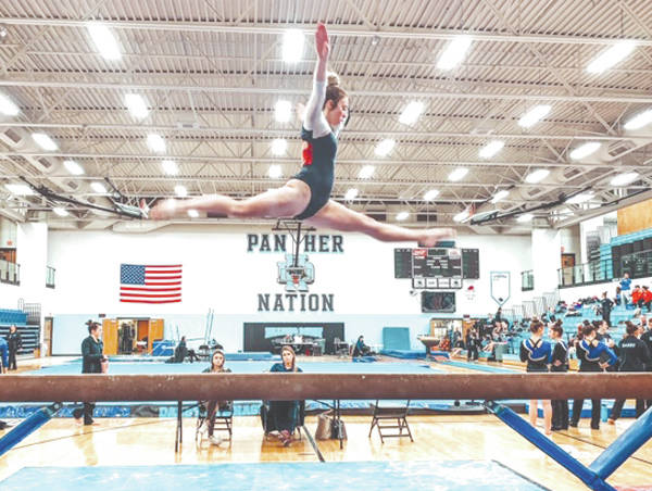 Greeneview junior Lizzy Valentine performs on the balance beam, during a recent high school gymnastics meet at Hilliard Davidson High School, near Columbus.